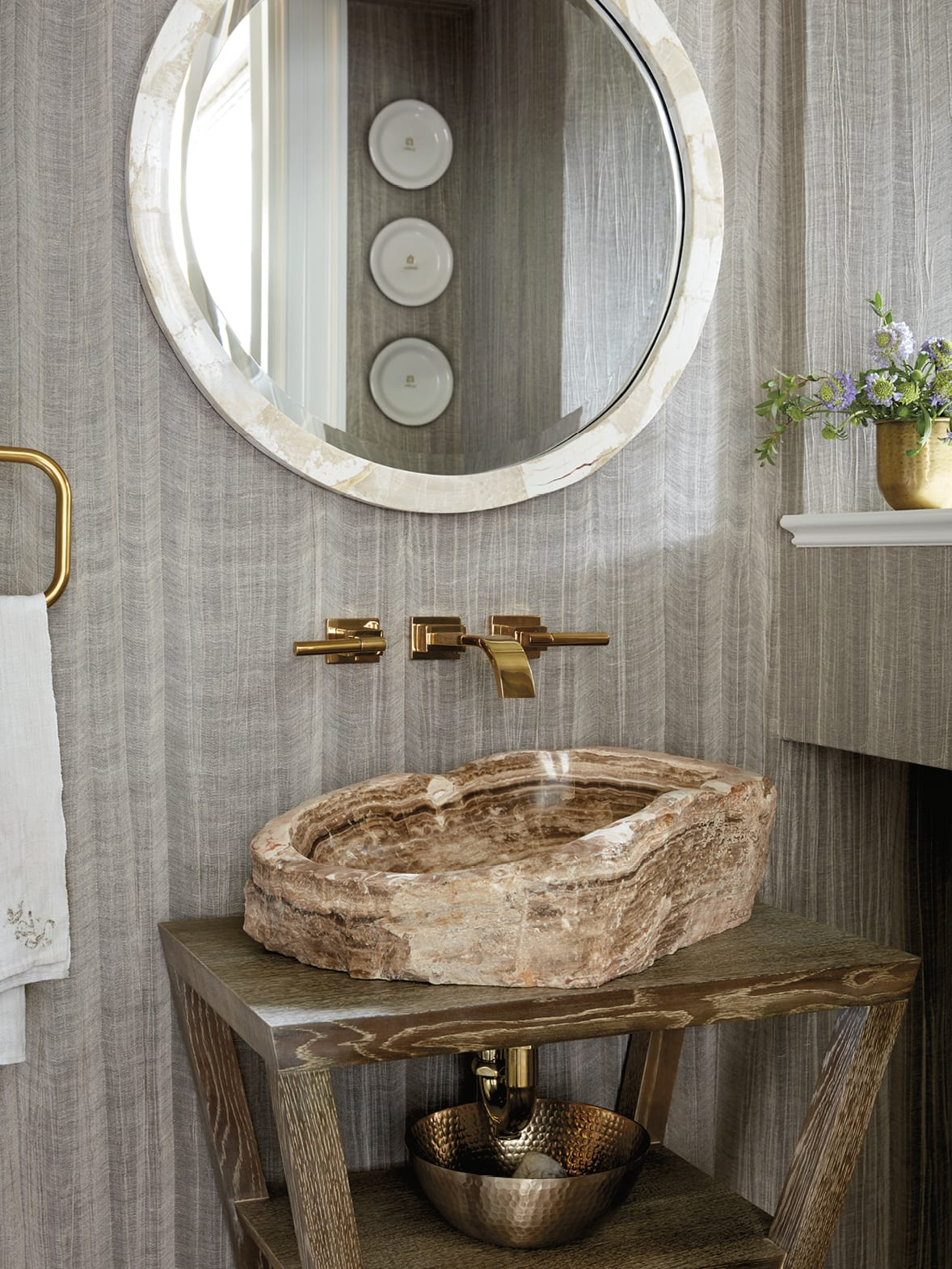 Bathroom with hand-carved stone sink