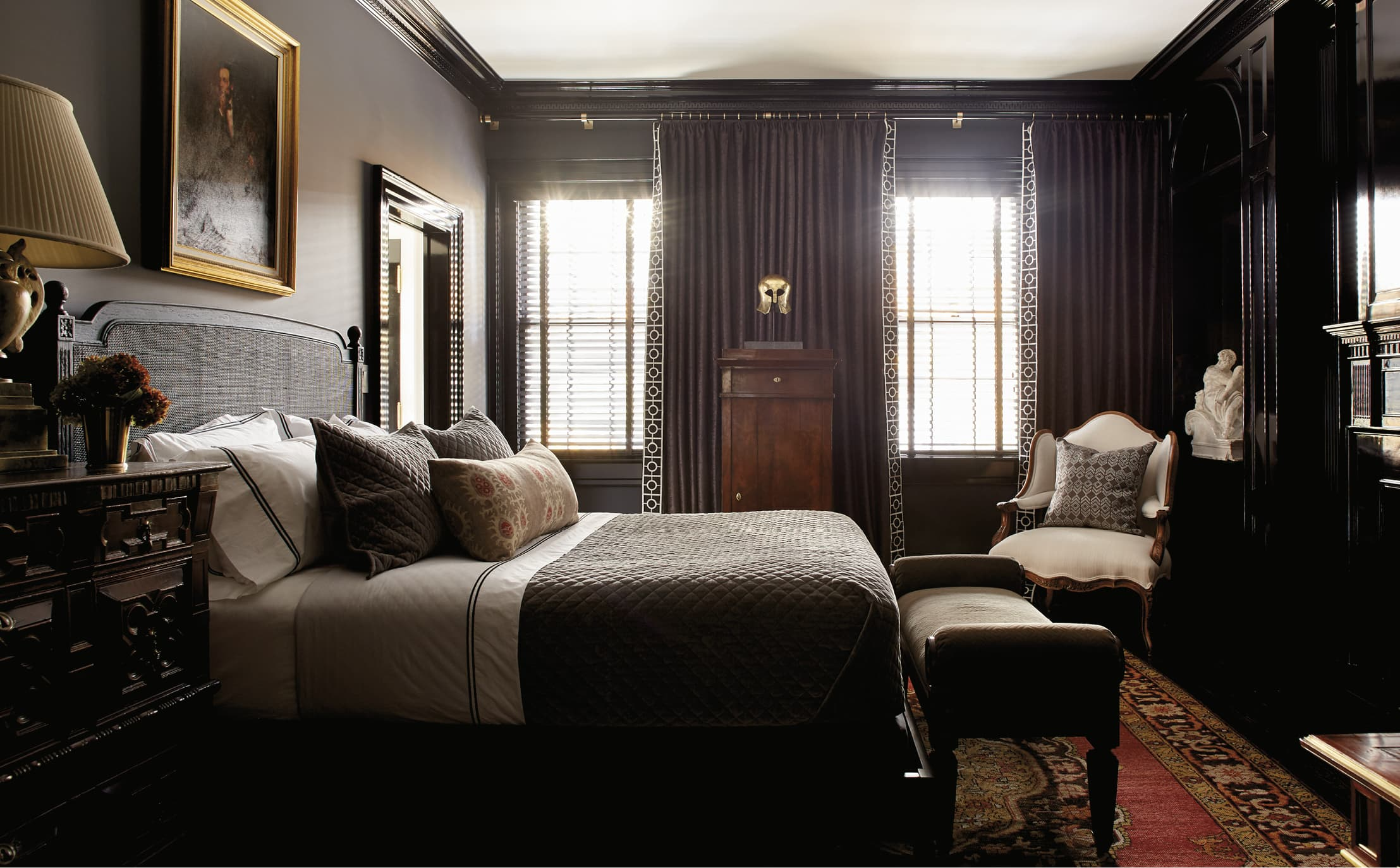 Dark colored bedroom with beautiful carved wood