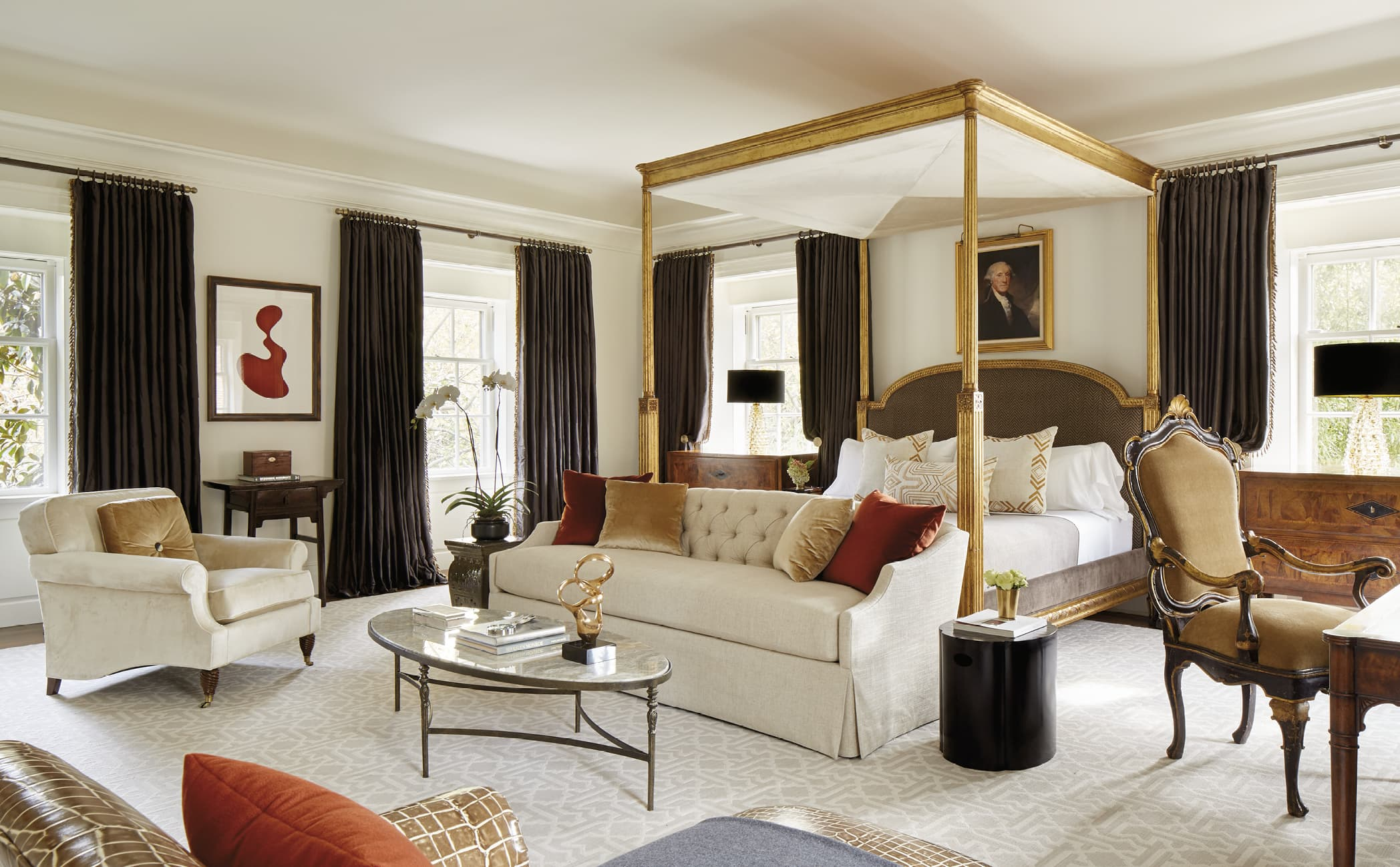 Large bedroom with canopy bed and seating area