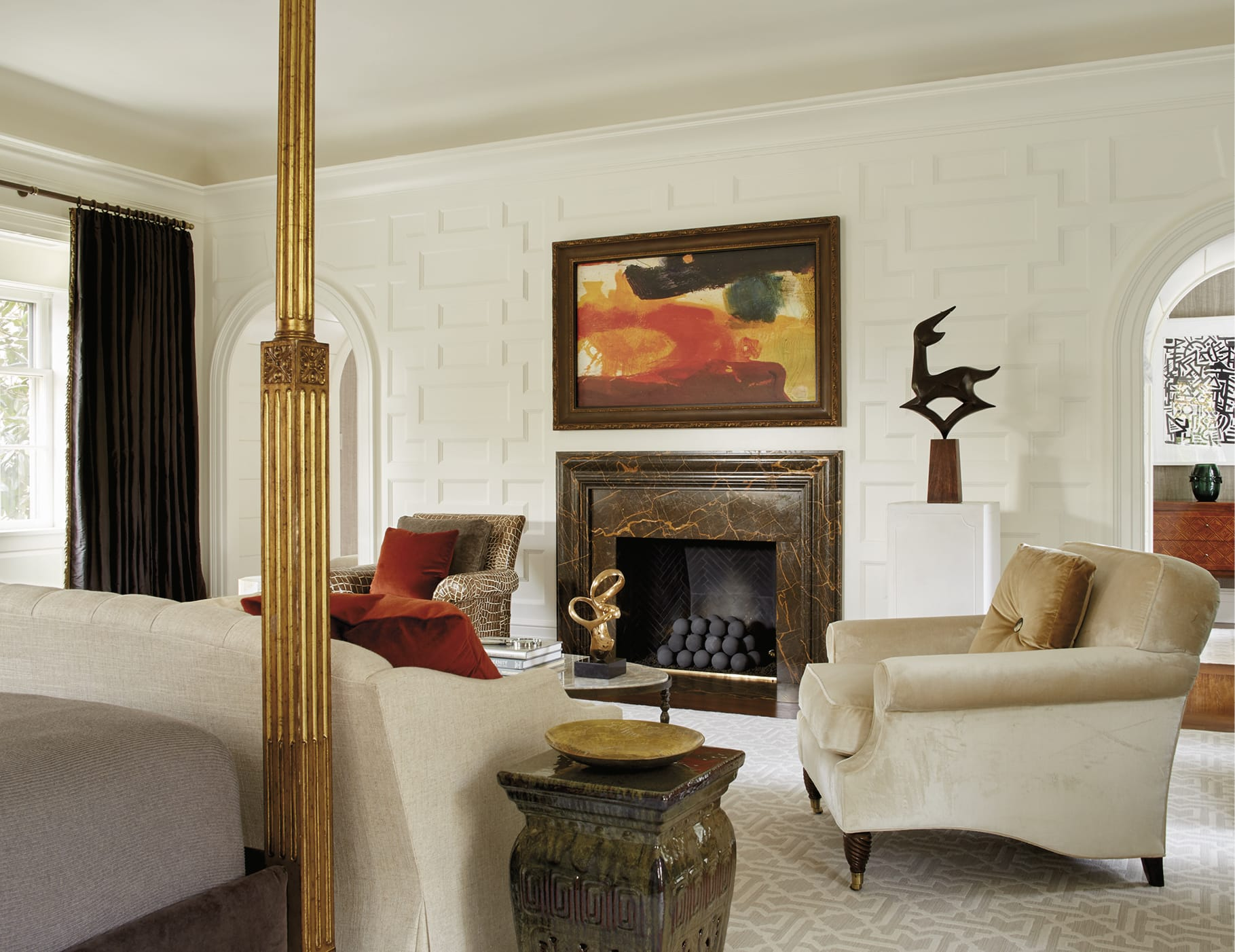 Bedroom seating area with a textured wall