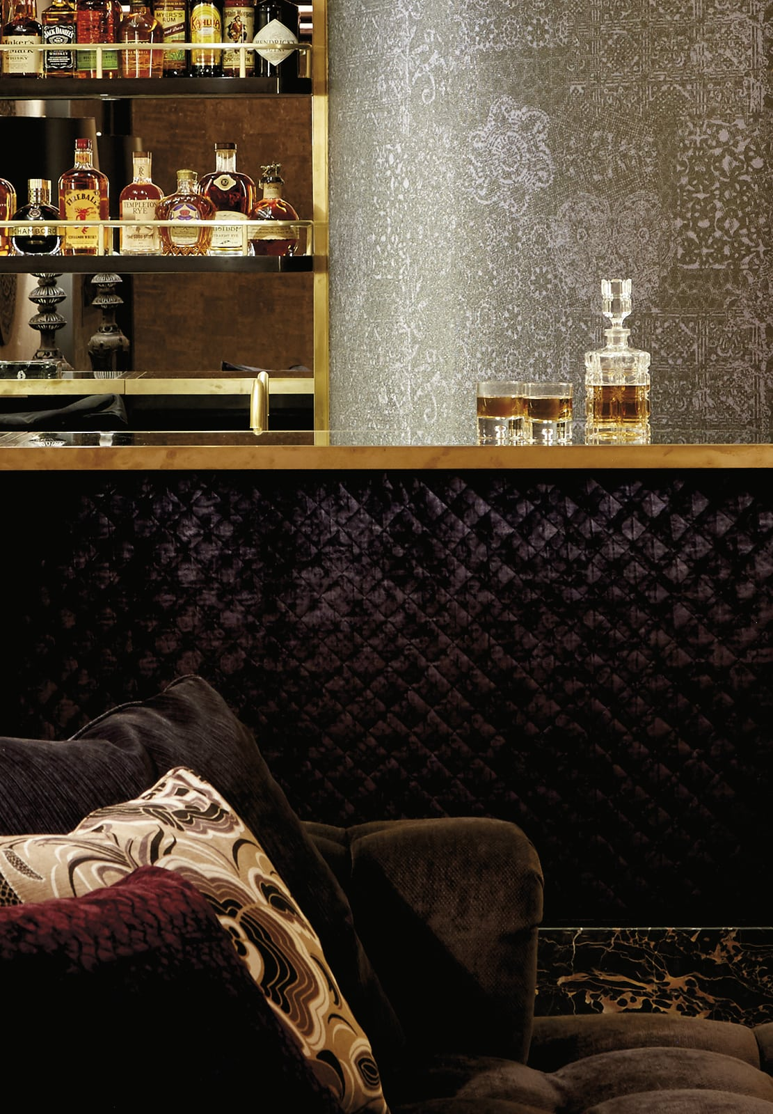 Richly textured bar with a whiskey decanter
