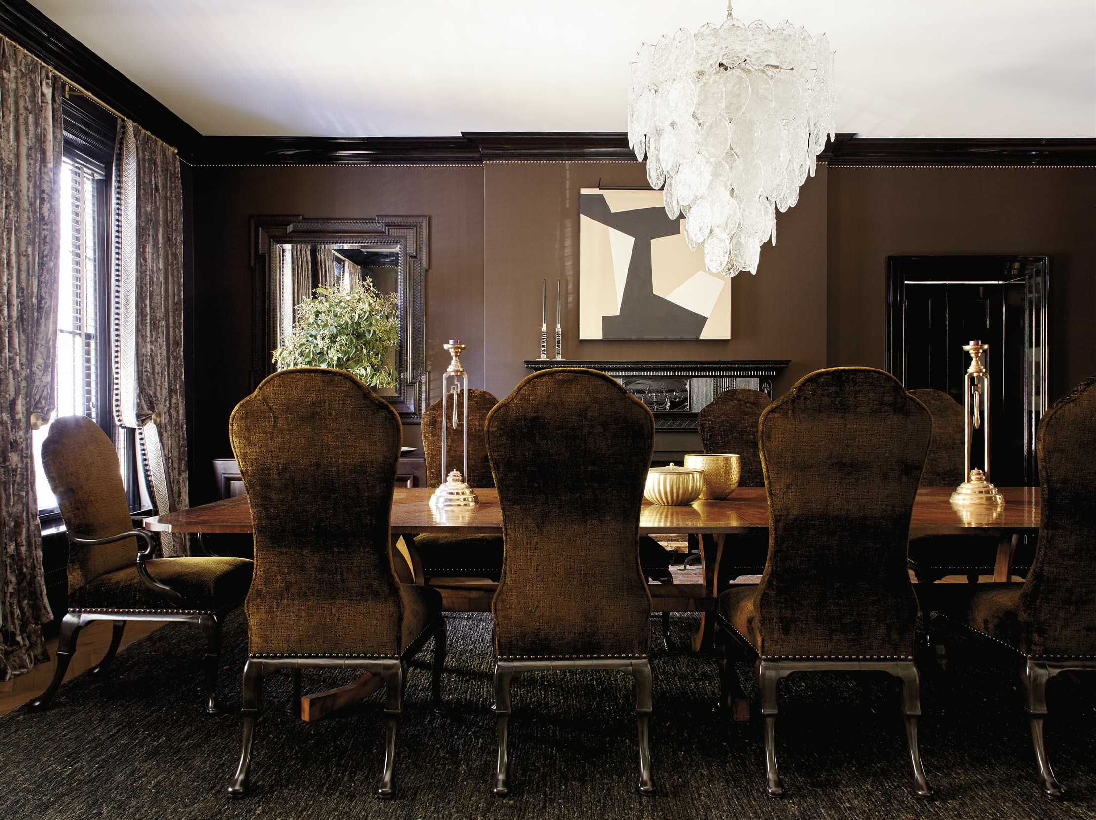 Dining room with brown walls and an interesting chandelier