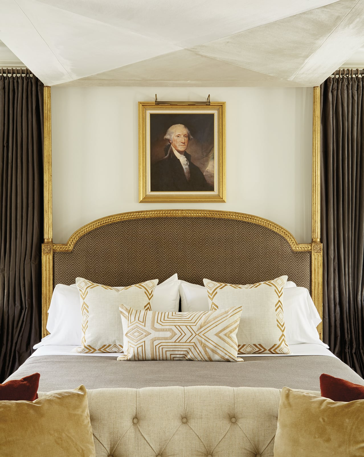 Canopy bed with a portrait of George Washington at the head