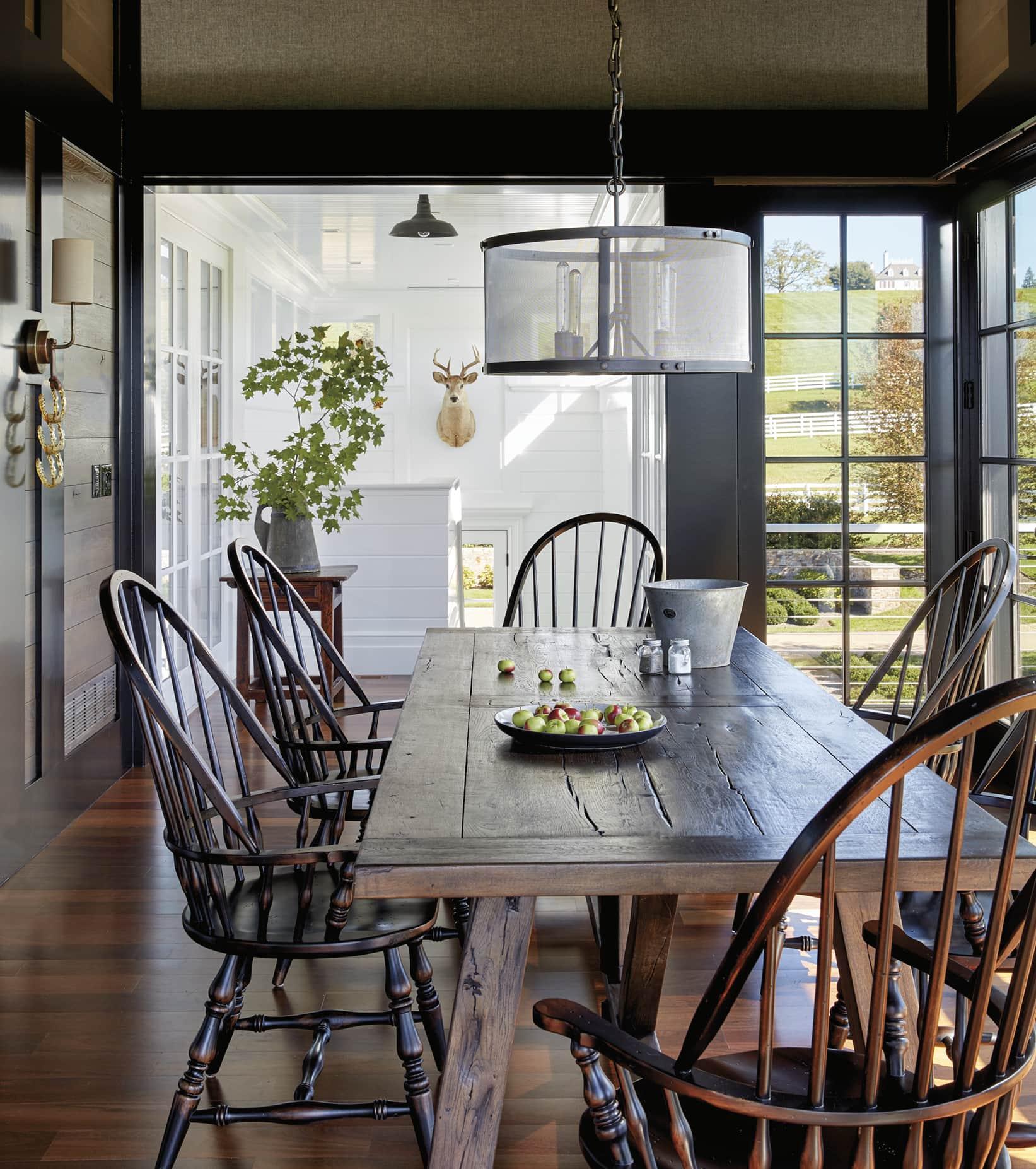 Sunny dining area with a farmhouse style table