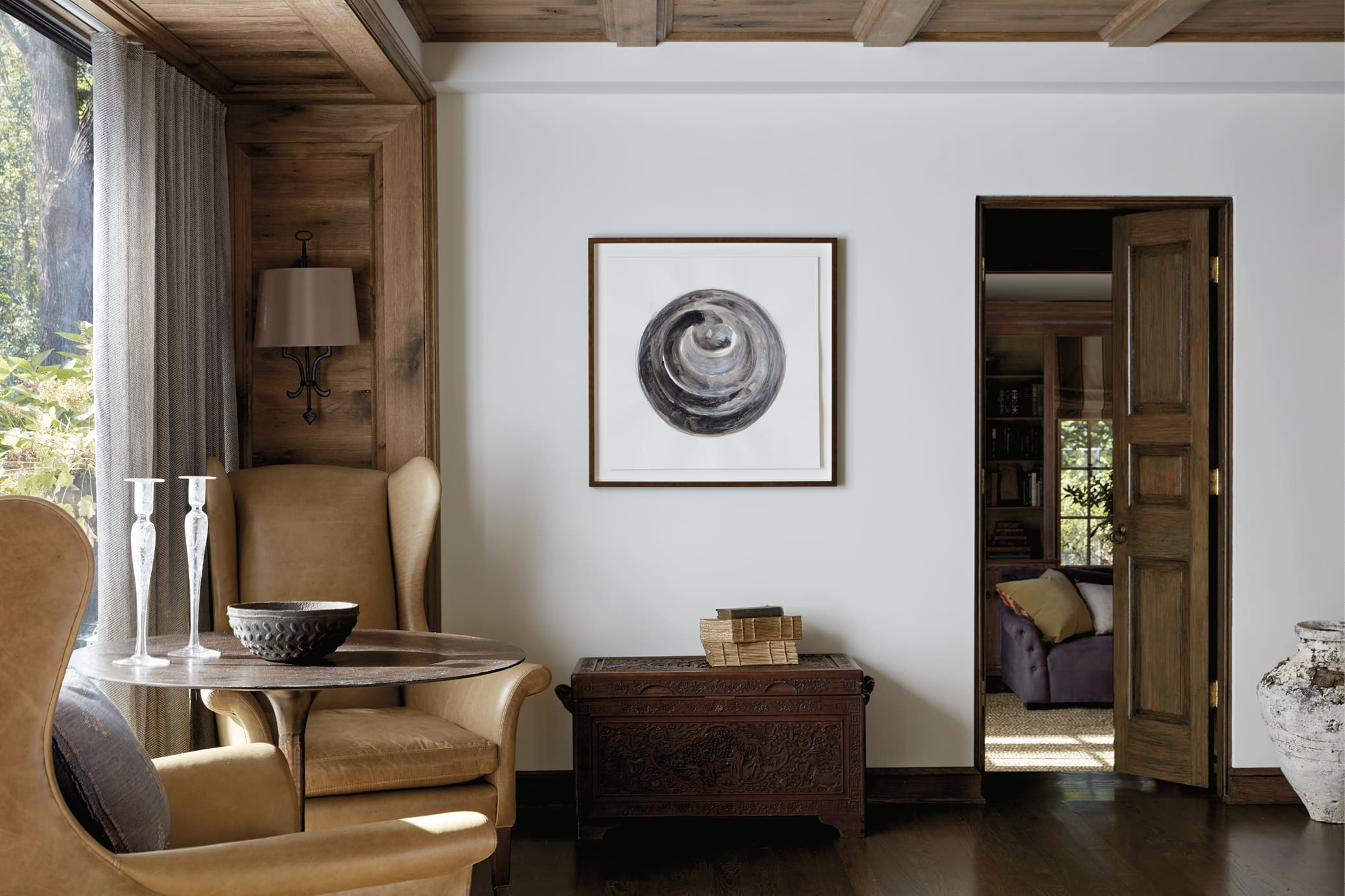 Sitting area with an abstract painting on the wall