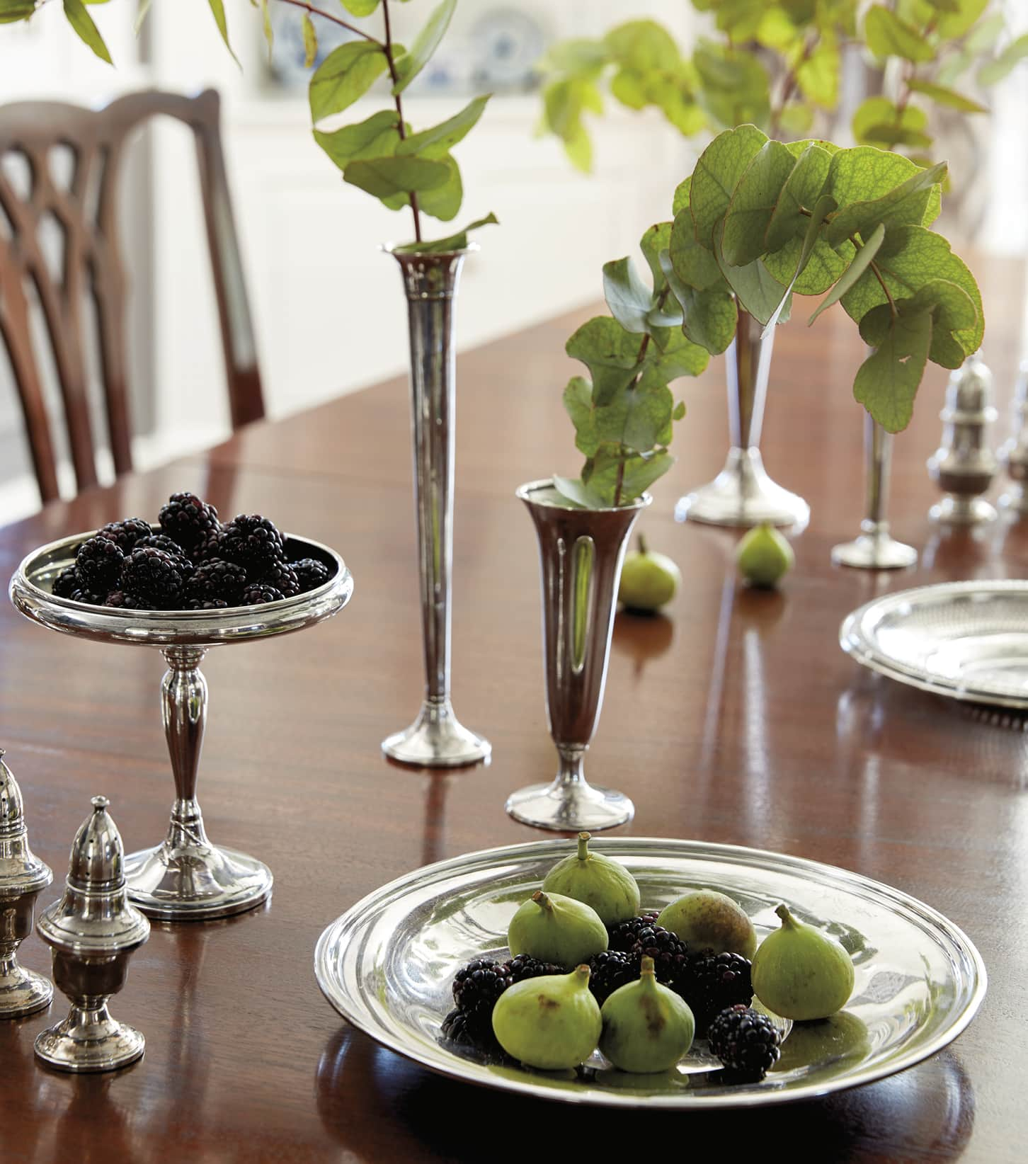 Figs and berries in a silver dish on the dining table