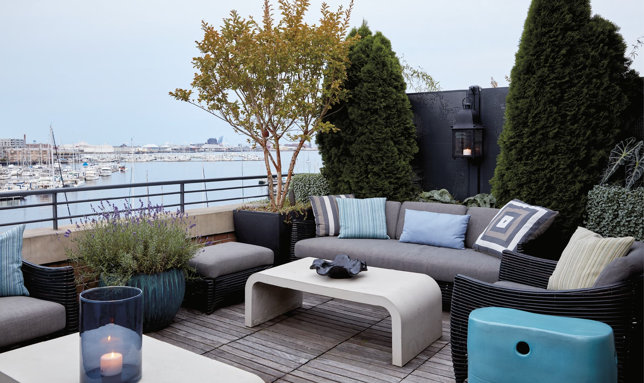 Outdoor porch area that looks out over a harbor