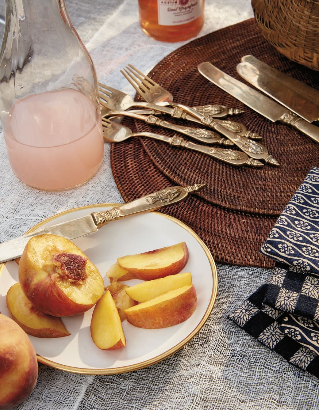Closeup of silverware and a plate of peaches