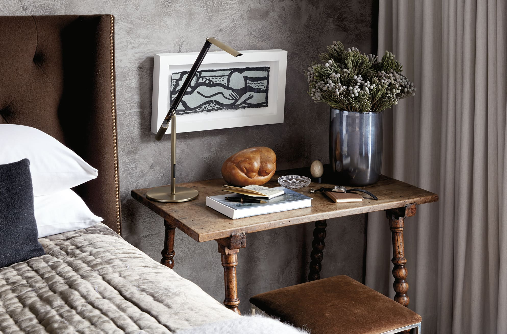 Books and flowers on a nightstand