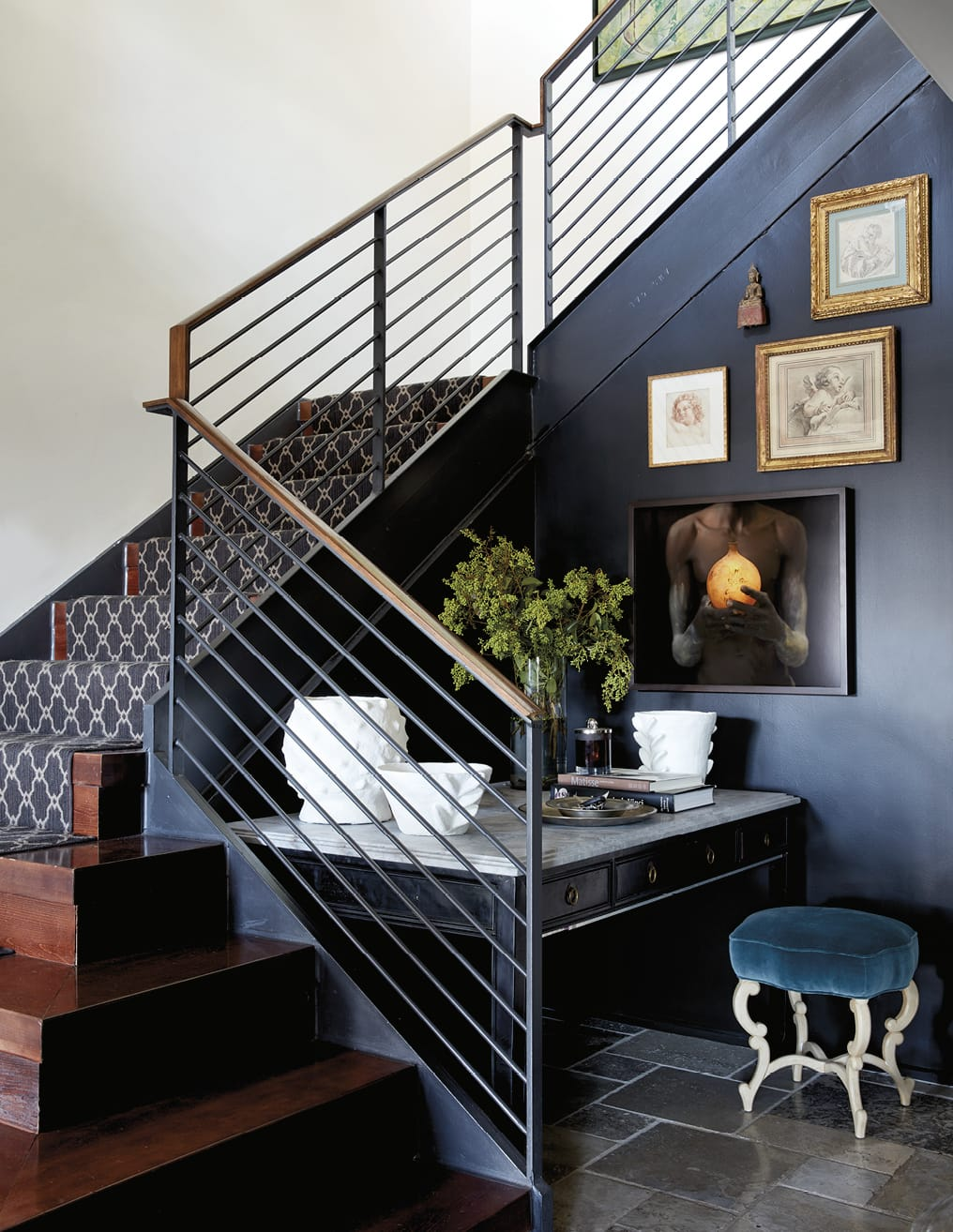 Writing desk nestled by a stairwell