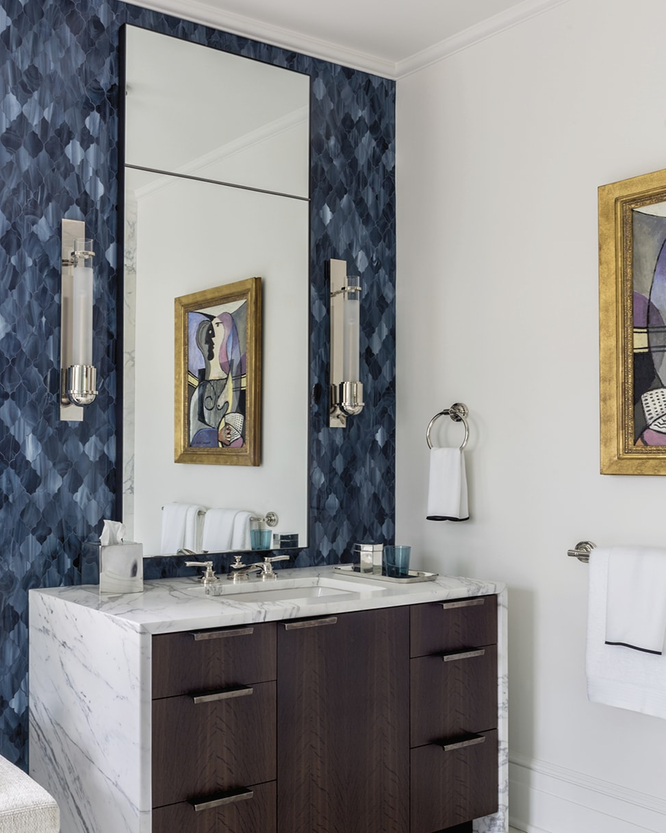 Bathroom with blue wall and white marble vanity