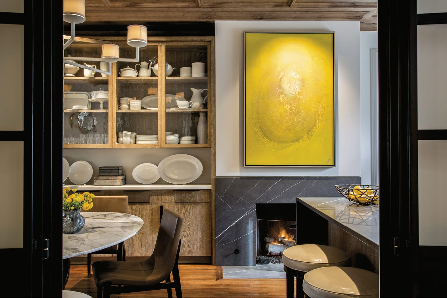 Open kitchen with fireplace and bright abstract painting