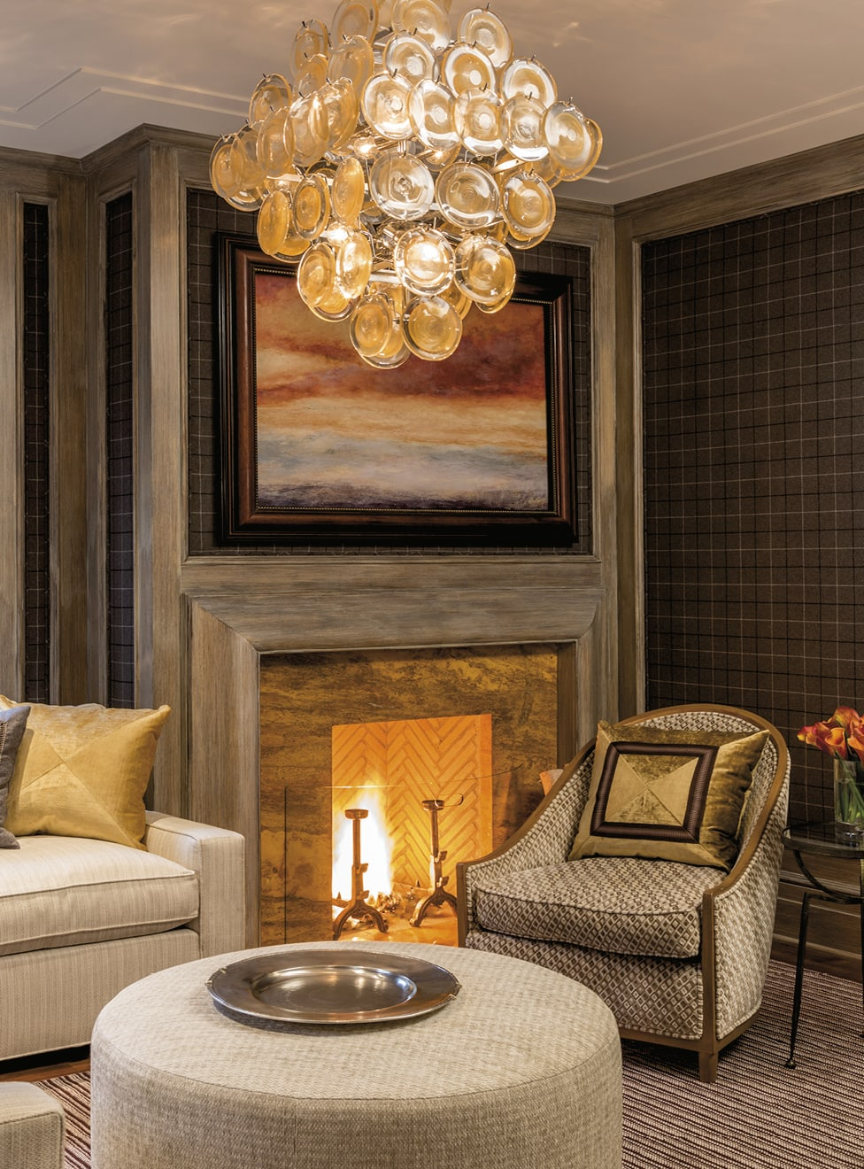 Sitting area with plaid walls and a fireplace