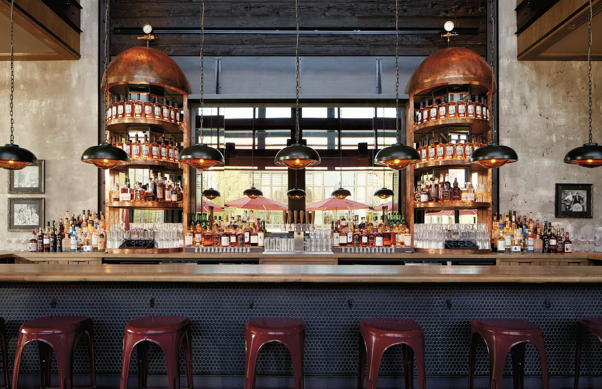 Bar with repurposed whiskey distillers