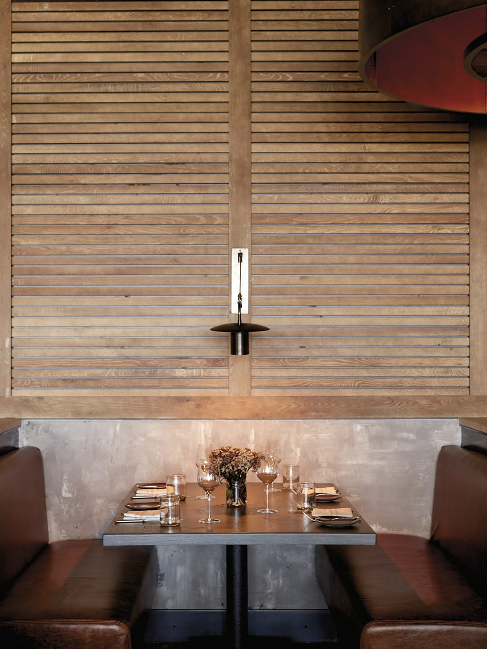 Restaurant table with a wooden slat wall