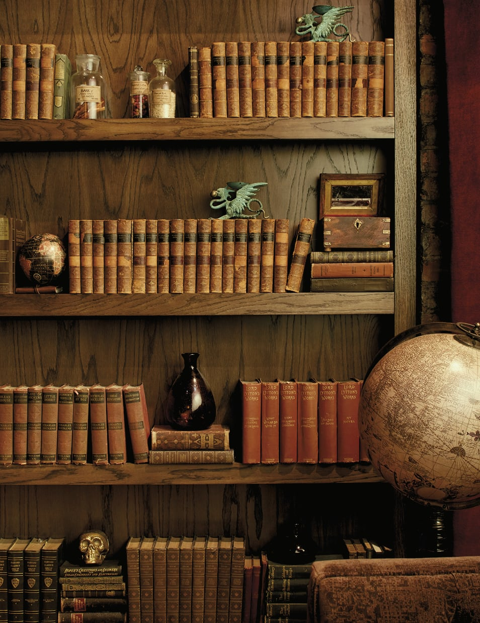 Bookshelf with interesting books and sculptures