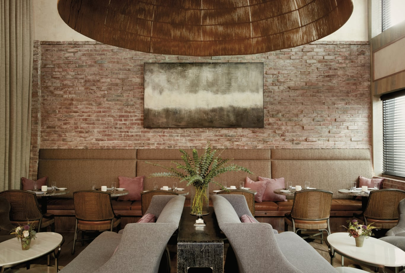 Restaurant bar area with a brick wall