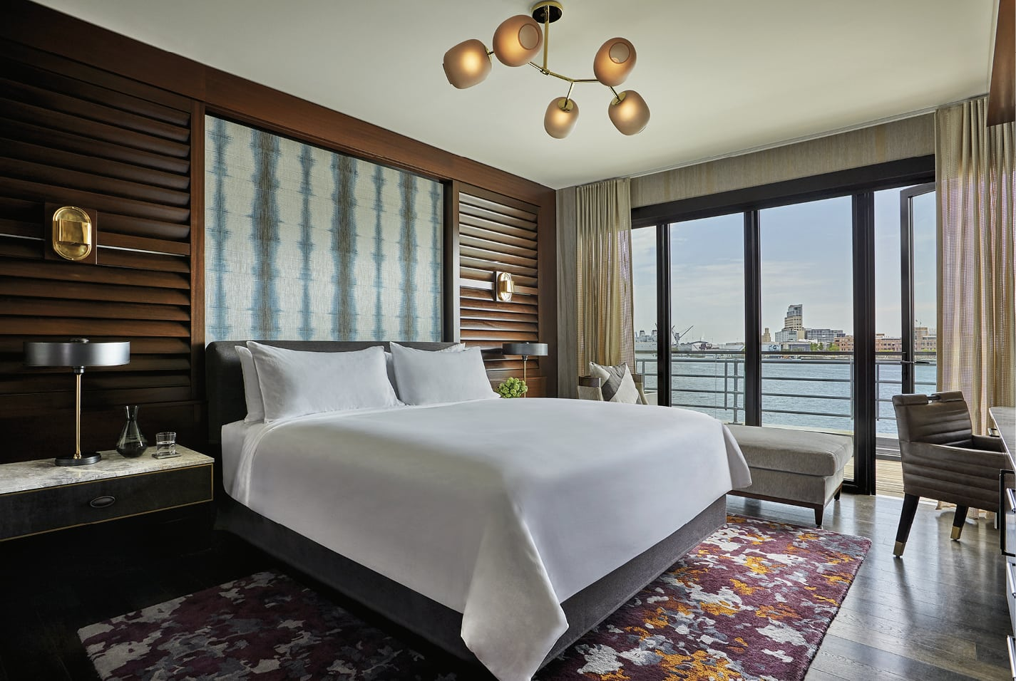 Hotel room interior that looks over the harbor