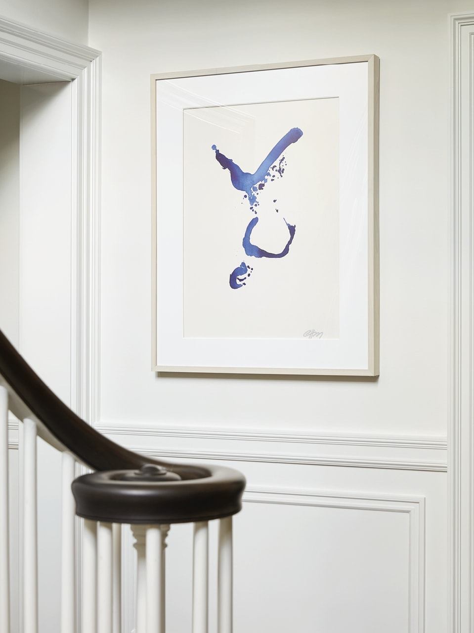 A beautiful painting above the stairway bannister