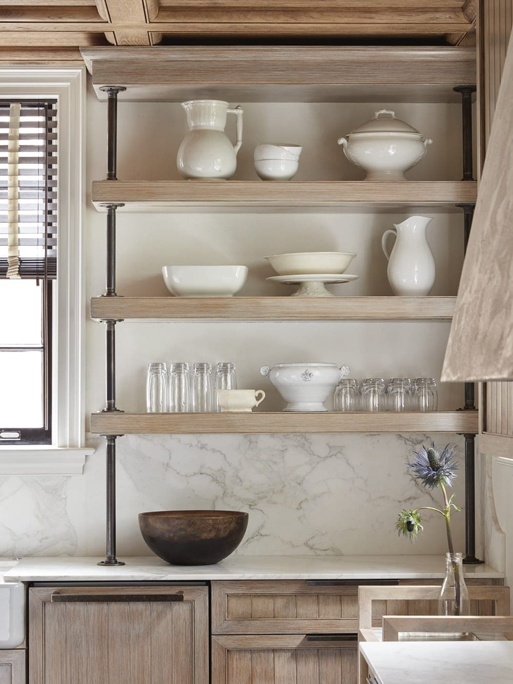 Kitchen shelves lined with white dishes
